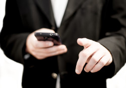 17744-business-man-holding-a-cell-phone-pv